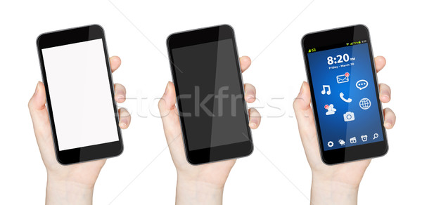 Hand with mobile phone Stock photo © sdecoret