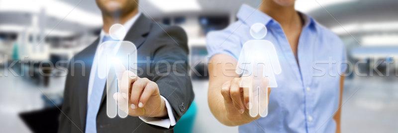 Man and woman using digital interface Stock photo © sdecoret