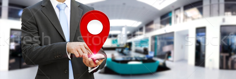 Businessman holding digital map in his hands Stock photo © sdecoret
