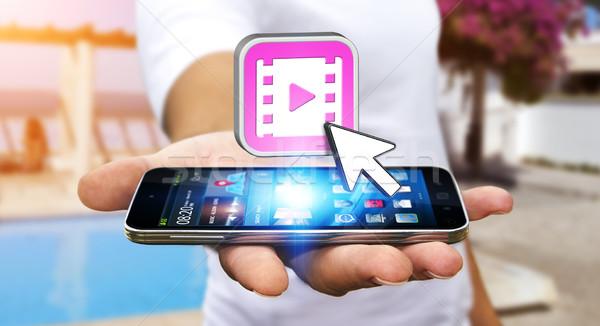 Jonge man moderne mobiele telefoon horloge video hand Stockfoto © sdecoret
