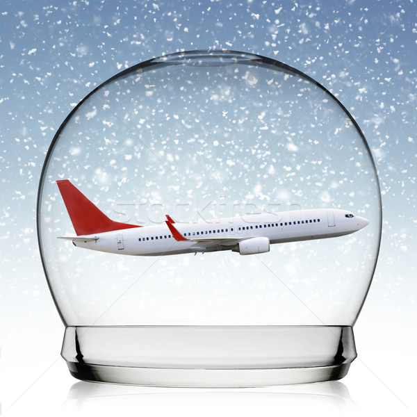 Plane flying in a snowball Stock photo © sdecoret