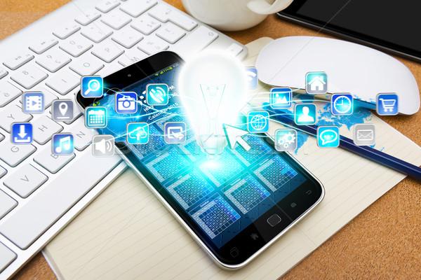 Modernes téléphone portable ampoule numérique icônes bureau Photo stock © sdecoret