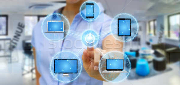 Businesswoman connecting tech device with his finger Stock photo © sdecoret