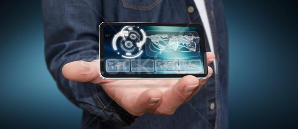 молодым человеком современных мобильного телефона бизнесмен стороны применение Сток-фото © sdecoret