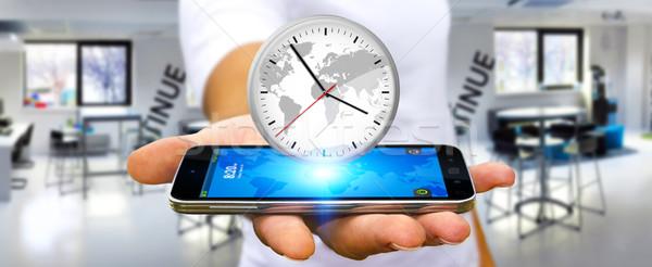 Işadamı saat cep telefonu büyük beyaz Stok fotoğraf © sdecoret