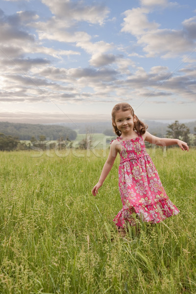 Lány sétál hosszú fű boldog fiatal lány Stock fotó © sdenness