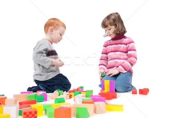 Gyerekek játszanak színes kockák izolált fehér árnyékok Stock fotó © sdenness