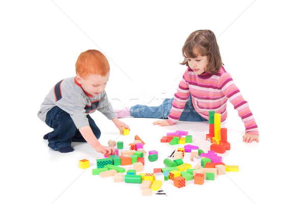 Kids playing with blocks Stock photo © sdenness