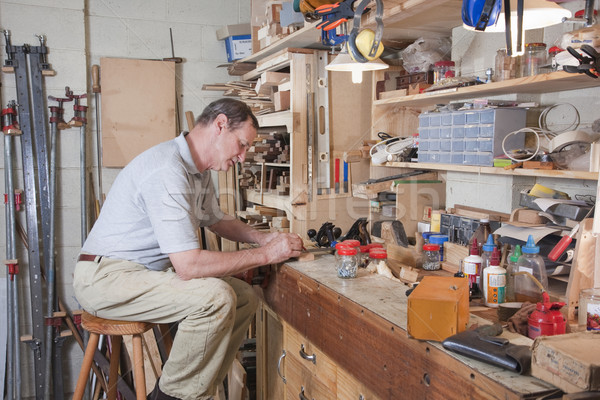 Busy at workbench Stock photo © sdenness