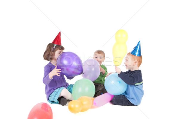 Gyerekek játék léggömbök buli három gyerekek játszanak Stock fotó © sdenness