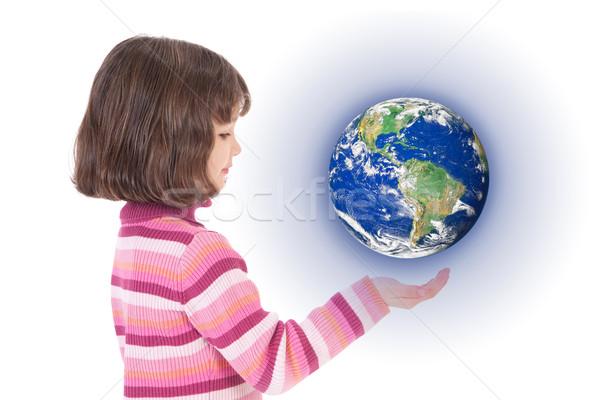 Girl holding world on hand Stock photo © sdenness