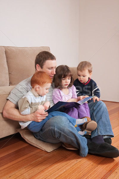 Dad reading story to kids Stock photo © sdenness