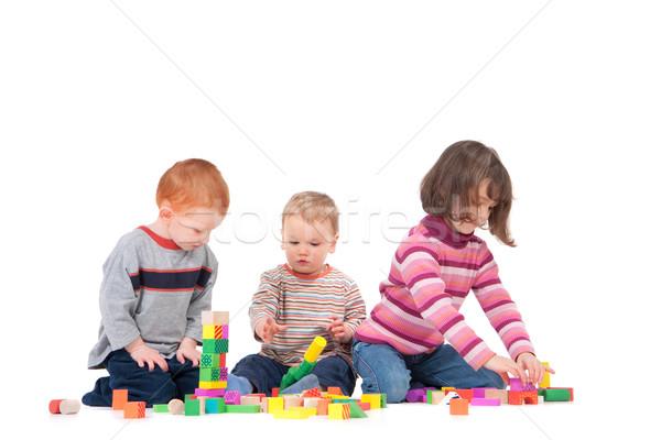 óvodások játszik fakockák három gyerekek játszanak izolált Stock fotó © sdenness
