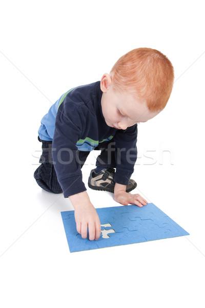 Fiú befejezés puzzle utolsó darab izolált Stock fotó © sdenness