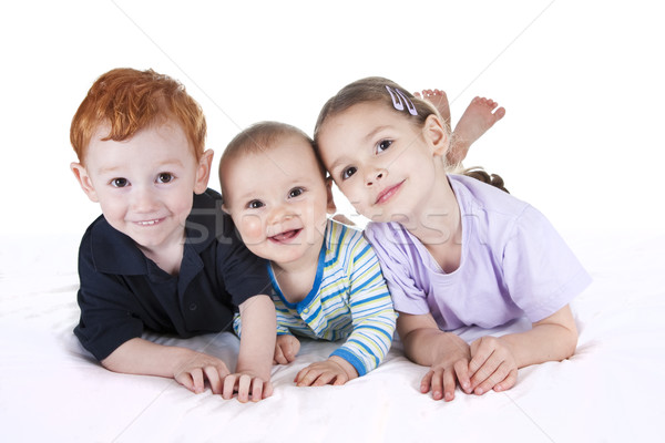 Gyerekek ágy három fehér izolált lány Stock fotó © sdenness