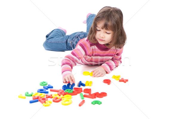 Lány tanul ábécé fiatal lány padló levelek Stock fotó © sdenness