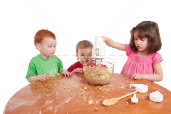 Gyerekek sütés sütik elektromos keverő izolált Stock fotó © sdenness