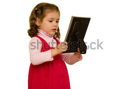 Fiatal lány néz képkeret izolált fehér szomorú Stock fotó © sdenness
