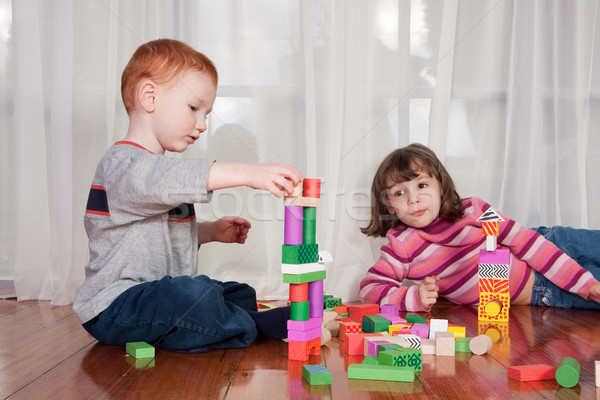 Kids playing with wooden blocks Stock photo © sdenness