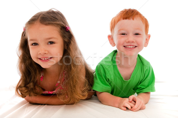 Happy kids lying down Stock photo © sdenness