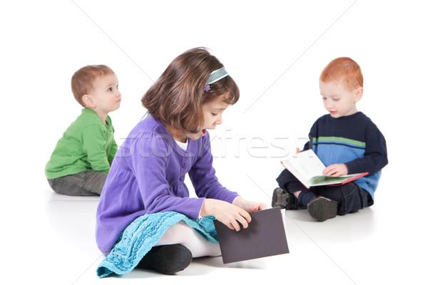 ül gyerekek olvas könyvek három padló Stock fotó © sdenness