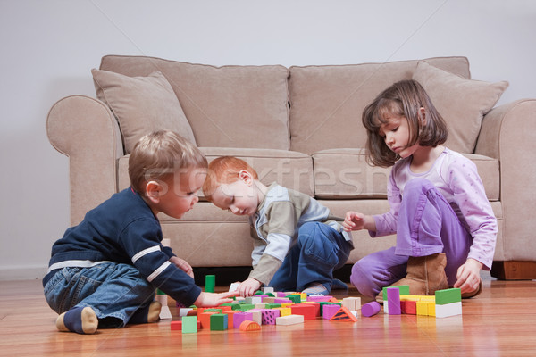 Preschoolers playing with blocks Stock photo © sdenness