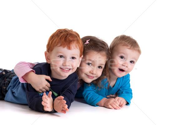 Trzy szczęśliwy dzieci piętrze wraz odizolowany Zdjęcia stock © sdenness