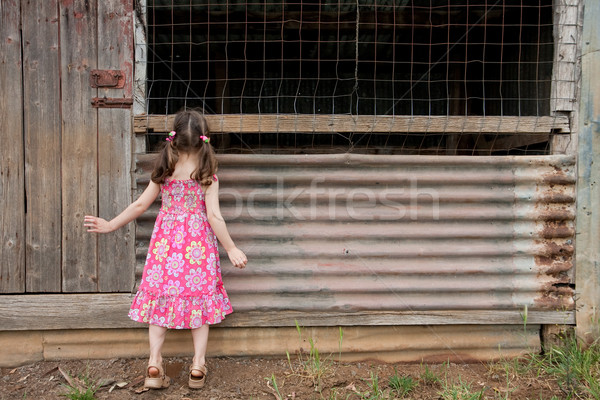 Stock photo: Inquisitive girl exploring old shed