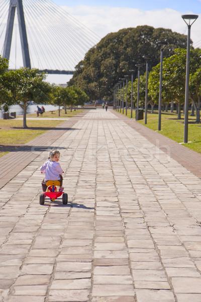 Genç kız şehir binicilik park liman köprü Stok fotoğraf © sdenness