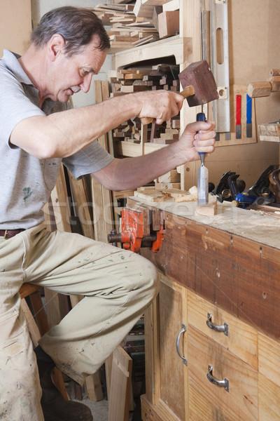 Idősebb férfi véső fa kalapács pad Stock fotó © sdenness