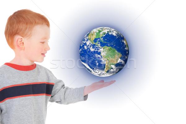 Jongen wereld hand hangend boven Stockfoto © sdenness
