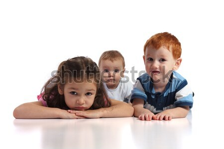 Three kids lying on floor Stock photo © sdenness