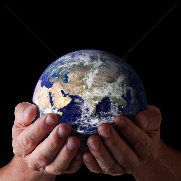 God wereld kruis handen geïsoleerd Stockfoto © sdenness