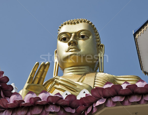 Buddha Looks Over The Golden Temple Stock photo © searagen
