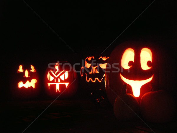 Four Glowing Halloween Pumpkins Stock photo © searagen
