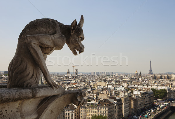 Horned Gargoyle With Eiffel Tower Stock photo © searagen