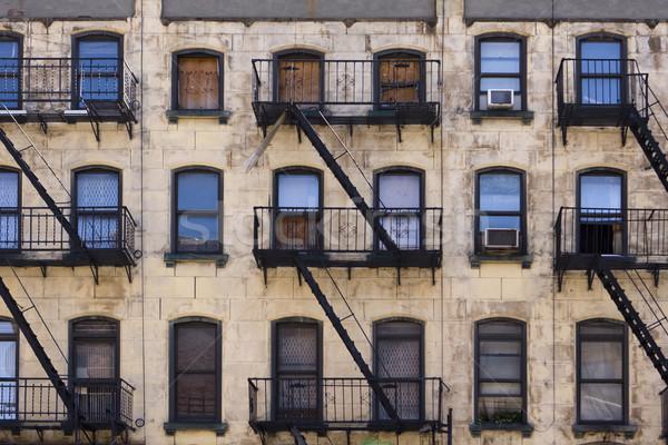 New York épület három padlók ablakok tűz Stock fotó © searagen