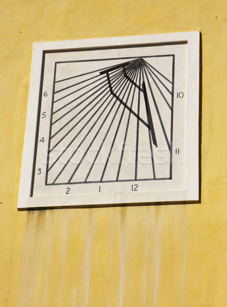 Sun Dial On Yellow Wall Stock photo © searagen