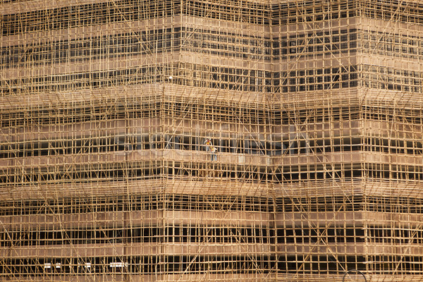 Hong Kong edificio construcción andamio dos hombres visible Foto stock © searagen