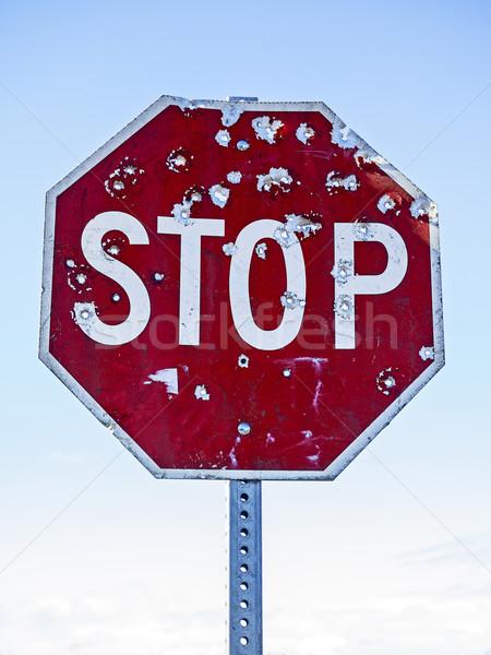 знак остановки пуля красный движения голубой небе Сток-фото © searagen