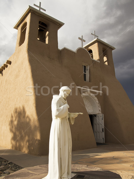 Saint Francis Statue With Church Stock photo © searagen