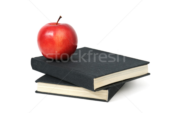 Stock photo: red apple on a book