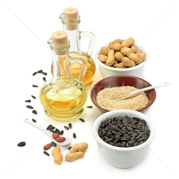 Sunflower seeds, peanuts and oil Stock photo © Serg64