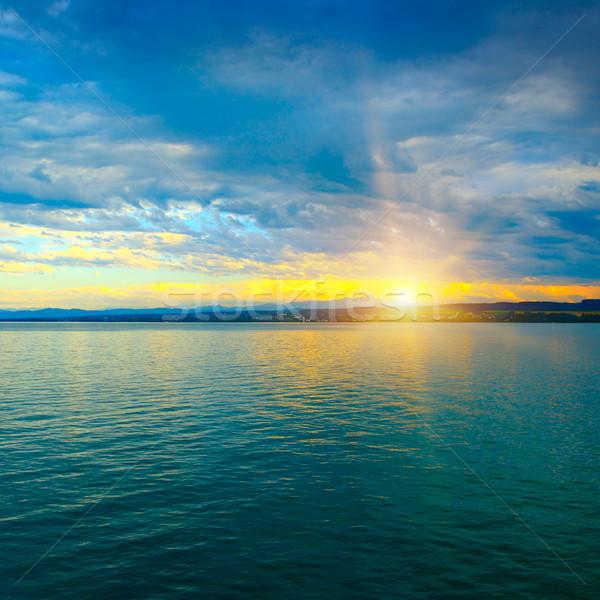 Hajnal fölött tenger kék ég víz nap Stock fotó © serg64