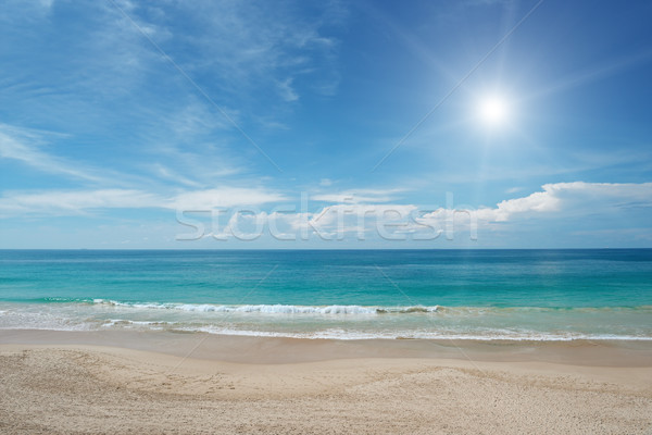 Sandy beach and sun in blue sky Stock photo © serg64