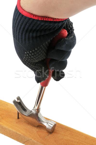 Carpenter pulls a nail. Stock photo © Serg64