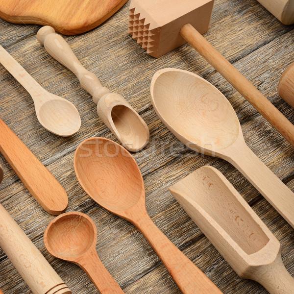 Set wooden kitchen utensils on wooden table. Stock photo © serg64