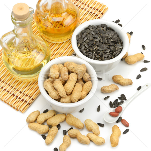 Sunflower seeds, peanuts and oil Stock photo © Serg64
