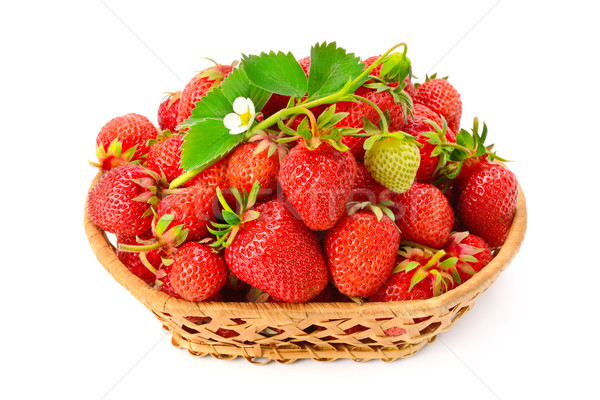 Stock photo: Ripe strawberries with flower in basket