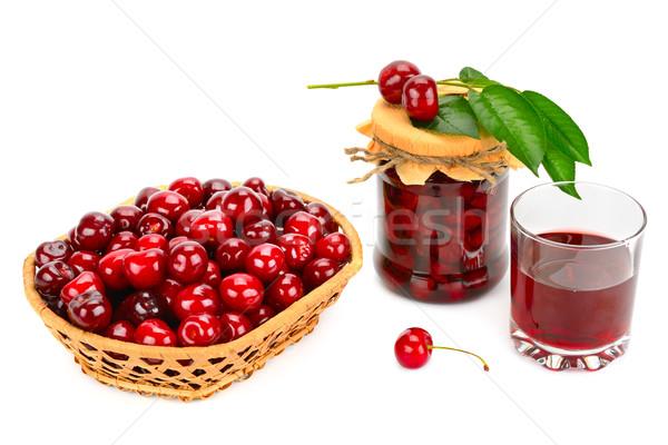 Glass of juice, basket of cherries and jar of jam Stock photo © Serg64